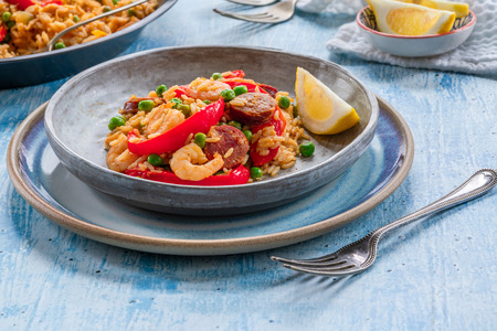 Spanish paella with prawns, chicken, chorizo and red pepper Stock fotó