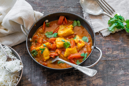 Fish Mappas - Kerala style coconut fish curry with rice. It's a popular dish in southern Indian state of Kerala. High angle view