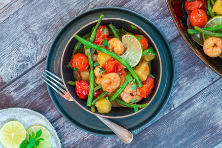 Thai prawns with pineapple and green beans - top view Фото со стока