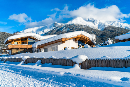 Beautiful winter landscape with snow covered houses and Alps in Seefeld in the Austrian state of Tyrol. Winter in Austria