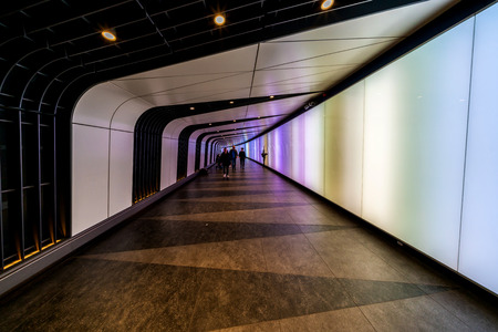 LONDON, UK - FEBRUARY 23, 2019: The 90 meters long curved pedestrian tunnel features an LED integrated lightwall and links St Pancras International and Kings Cross St Pancras Underground stations