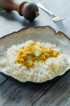 Haddock in creamed coconut and corn curry with rice