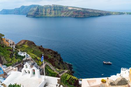 View of volcano caldera and Aegean Sea in Oia, Santorini, Greece