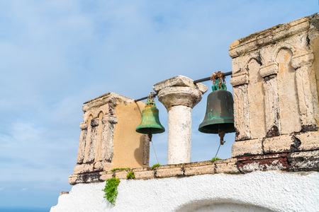 Old church bells against blue sky in Oia, Santorini, Greece