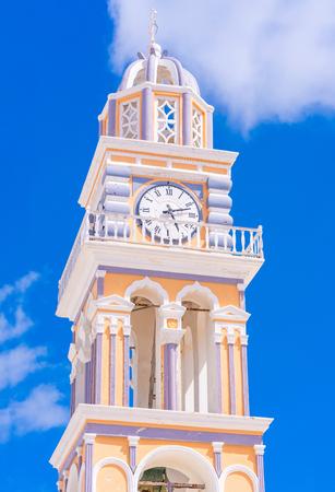 Clocktower of Cathedral of Saint John the Baptist in Fira Santorini, Greece Stock Photo