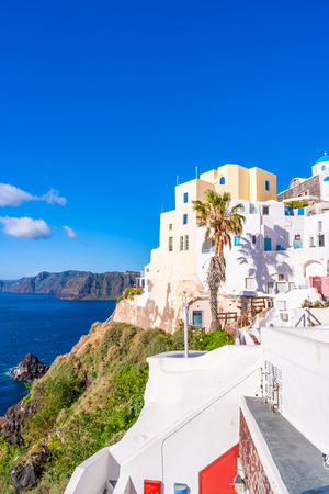 Santorini landscape with traditional whitewashed houses and view of Aegean Sea in Oia, Greece