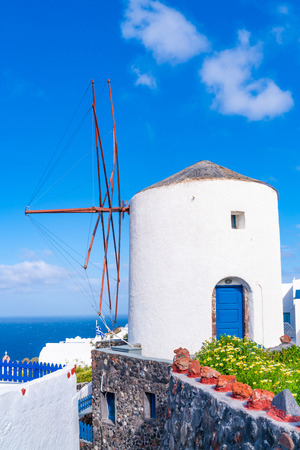 Traditional white windmill in Oia on Cyclades island of Santorini, Greece