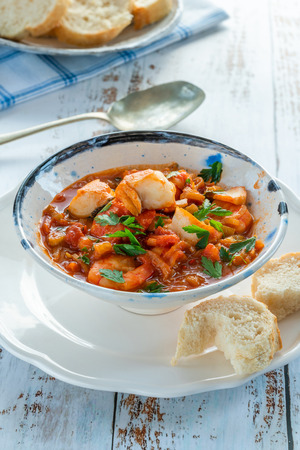 Tiger prawn and fish stew in a bowl