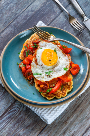 Sweetcorn pancakes with fried egg and chorizo and red pepper salsa - high angle view Reklamní fotografie