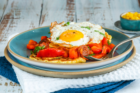 Sweetcorn pancakes with fried egg and chorizo and red pepper salsa