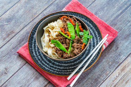Chinese five-spice beef and sugar snap noodles - high angle view