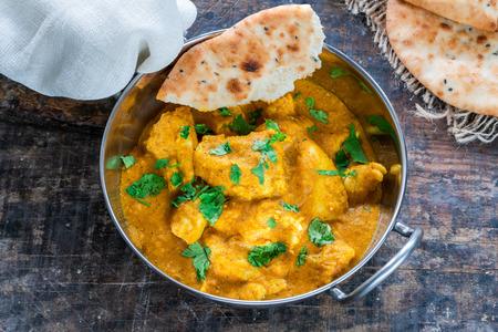 Chicken korma curry with naan bread - high angle view