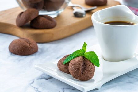 Coffee bean cookies with espresso coffee in a cup