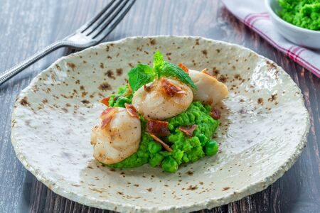 Scallops with minted peas and crispy pancetta - closeup