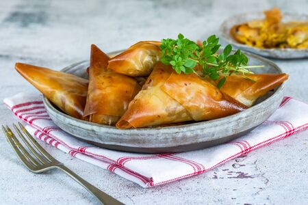 Chicken samosas with almond and apricot - asian snack idea