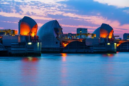 LONDON, UK - JUNE 29, 2019: Thames Barrier is the worlds second largest movable flood barrier. It prevents most of Greater London from being flooded by exceptionally high tides since 1982