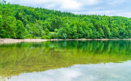 Nussensee lake in Upper Austria located near Bad Ischl in the Salzkammergut - wide panoramic view.