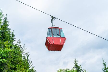 Red vintage gondola of Mount Katrin cable car in Bad Ischl, Salzkammergut, Austria Stock Photo - 128573349