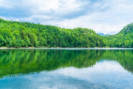 Nussensee lake in Upper Austria located near Bad Ischl in the Salzkammergut - wide panoramic view. Stock Photo - 128573372