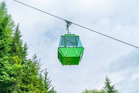 Green vintage gondola of Mount Katrin cable car in Bad Ischl, Salzkammergut, Austria