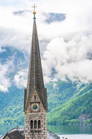 Clock tower of Neo Gothic Evangelical Church in Hallstatt on Hallstatter Lake in Salzkammergut region in Austria
