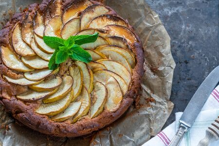 Apple, ginger and honey cake garnished with fresh mint - overhead view