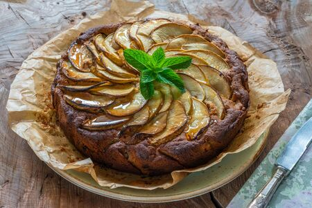 Apple, ginger and honey cake garnished with fresh mint Stock Photo
