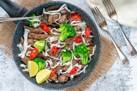 Beef and broccoli noodles - top view Stock Photo