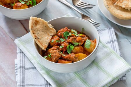 Aloo gosht with naan bread - lamb and potato curry - cuisine popular in Pakistan, Bangladesh and North India