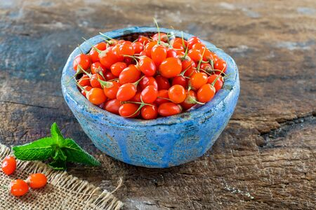 Fresh goji berries in a bowl - closeup.
