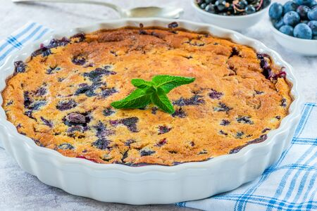 Lemon, blueberry and blackberry clafoutis - delicious baked fruit dessert
