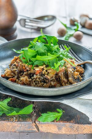 Mushroom, chorizo and thyme risotto with rocket lettuce