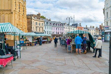CIRENCESTER, UK - SEPTEMBER 23, 2019: Cirencester's Charter Market held in the Market Place on Mondays and Fridays is one of the oldest in the country and was mentioned in 1086 in the Domesday Book