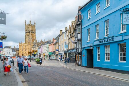 CIRENCESTER, UK - SEPTEMBER 23, 2019: Colorful buildings in the Market Place in the town centre of Cirencester, a market town in Gloucestershire, often referred to as the Capital of the Cotswolds