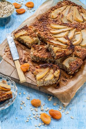 Pear, apricot, almond and oats breakfast squares - high angle view