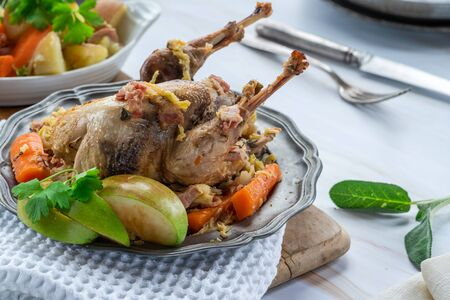 Pot-roast pheasant in cider with bacon and vegetables