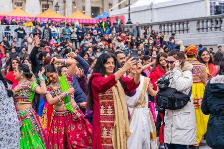 LONDON, UK - NOVEMBER 03, 2019: People take part in Diwali celebrations in London. Diwali, or Deepawali is the Hindu festival of lights celebrated during the Hindu Lunisolar month Kartika. Фото со стока - 133786655