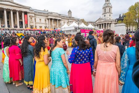 LONDON, UK - NOVEMBER 03, 2019: People take part in Diwali celebrations in London. Diwali, or Deepawali is the Hindu festival of lights celebrated during the Hindu Lunisolar month Kartika. Фото со стока - 133786659