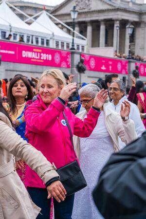 LONDON, UK - NOVEMBER 03, 2019: People take part in Diwali celebrations in London. Diwali, or Deepawali is the Hindu festival of lights celebrated during the Hindu Lunisolar month Kartika.