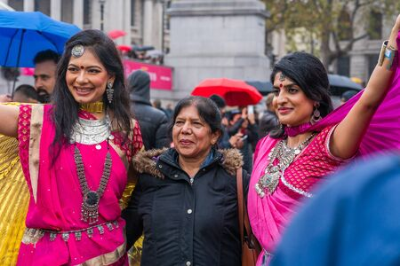 LONDON, UK - NOVEMBER 03, 2019: People take part in Diwali celebrations in London. Diwali, or Deepawali is the Hindu festival of lights celebrated during the Hindu Lunisolar month Kartika. Фото со стока - 133786666