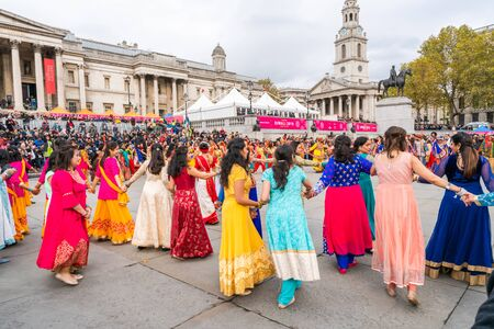 LONDON, UK - NOVEMBER 03, 2019: People take part in Diwali celebrations in London. Diwali, or Deepawali is the Hindu festival of lights celebrated during the Hindu Lunisolar month Kartika. Фото со стока - 133786667