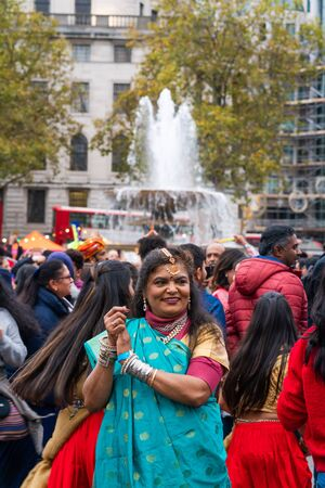 LONDON, UK - NOVEMBER 03, 2019: People take part in Diwali celebrations in London. Diwali, or Deepawali is the Hindu festival of lights celebrated during the Hindu Lunisolar month Kartika. Фото со стока - 133786668