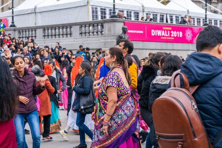 LONDON, UK - NOVEMBER 03, 2019: People take part in Diwali celebrations in London. Diwali, or Deepawali is the Hindu festival of lights celebrated during the Hindu Lunisolar month Kartika. Фото со стока - 133786669