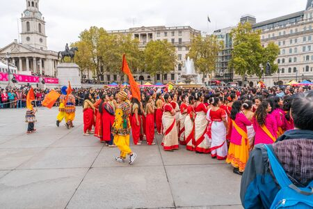 LONDON, UK - NOVEMBER 03, 2019: People take part in Diwali celebrations in London. Diwali, or Deepawali is the Hindu festival of lights celebrated during the Hindu Lunisolar month Kartika. Фото со стока - 133786670