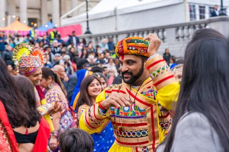 LONDON, UK - NOVEMBER 03, 2019: People take part in Diwali celebrations in London. Diwali, or Deepawali is the Hindu festival of lights celebrated during the Hindu Lunisolar month Kartika. Фото со стока - 133786671