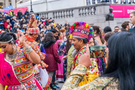 LONDON, UK - NOVEMBER 03, 2019: People take part in Diwali celebrations in London. Diwali, or Deepawali is the Hindu festival of lights celebrated during the Hindu Lunisolar month Kartika. Фото со стока - 133786674