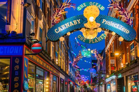 LONDON - NOVEMBER 09 2019:This year Carnaby Street in collaboratiion with ocean conservation charity Project Zero creates more eco-friendly Christmas display made using recycled and reusable materials Фото со стока - 133786765