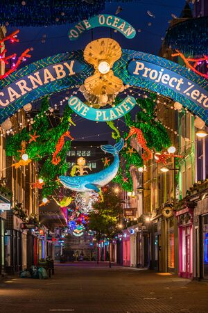 LONDON - NOVEMBER 09 2019:This year Carnaby Street in collaboratiion with ocean conservation charity Project Zero creates more eco-friendly Christmas display made using recycled and reusable materials Фото со стока - 133786768