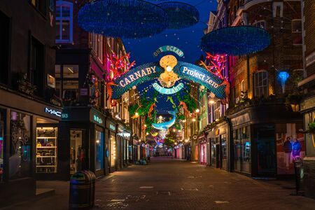 LONDON - NOVEMBER 09 2019:This year Carnaby Street in collaboratiion with ocean conservation charity Project Zero creates more eco-friendly Christmas display made using recycled and reusable materials Фото со стока - 133786771