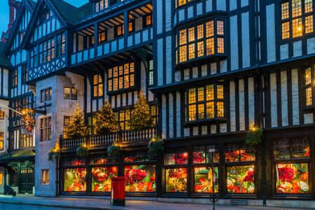 LONDON - NOVEMBER 09, 2019: Liberty's, Luxury department store opened in 1875 in Great Marlborough Street, in the West End of London is decorated for Christmas. It sells a wide range of luxury goods 報道画像